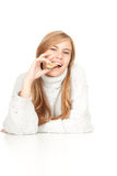 Energy food, young woman eating granola bar. White background Royalty Free Stock Images