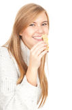Energy food, young woman eating granola bar. Healthy lifestyle, smiling young woman with granola bar, white background Royalty Free Stock Photography