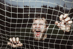 Energy furious bearded athlete screaming holding net Royalty Free Stock Images