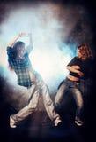 Energy generation. Modern hip-hop dancers over grunge background. Urban, disco style Stock Image