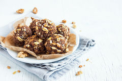 Energy granola bites. Healthy organic energy granola bites with nuts, cacao, banana and honey - vegan vegetarian raw snack or meal Stock Images