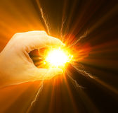 Energy in hand. Abstract photo of a hand holding a bright energy light Royalty Free Stock Photos