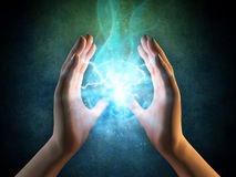 Energy from hands. Two hands creating an energy sphere. Digital illustration Stock Photos