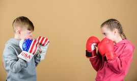 Energy health. punching knockout. Childhood activity. Sport success. Friendship fight. workout of small girl and boy. Boxer. Happy children in boxing gloves royalty free stock photography