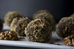 Energy healthy homemade truffles. Uncooked sweet balls made from walnuts and biscuits. Energy healthy homemade truffles. Uncooked sweet balls stock images