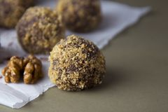 Energy healthy homemade truffles. Uncooked sweet balls made from walnuts and biscuits. Energy healthy homemade truffles. Uncooked sweet balls stock photos