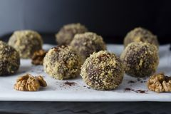 Energy healthy homemade truffles. Uncooked sweet balls made from walnuts and biscuits. Energy healthy homemade truffles. Uncooked sweet balls stock photography
