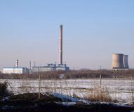 central heating,thermal power plant,winter,seen over the fence royalty free stock photos