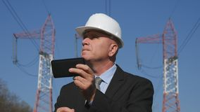Energy Industry Engineer Use Cell Phone in Maintenance Activity.  royalty free stock photo