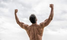Energy inside. Bodybuilder showing muscles. muscular back man isolated on white. torso and back training sport. sport. Success. celebrating success. welcome new royalty free stock photo