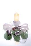 Energy lamp. A collection of bulbs surrounding a lighted energy bulb Stock Photos