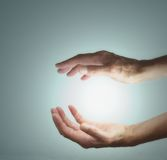 Energy Manifestation. Female healer with outstretched hands sensing energy between hands Royalty Free Stock Image