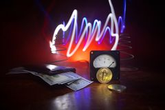 Energy for mining cryptocurrency. The energy meter with bitcoin and money on dark toned foggy background. Power Counter Meter Volt. Age Measuring Outlet Power royalty free stock image
