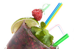 Energy mohito with mint, lime and raspberry Stock Photos