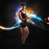 Energy of muscular woman. Muscular woman with colorful light effects background Royalty Free Stock Photo
