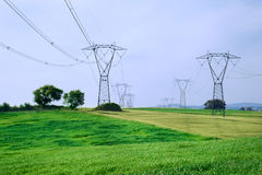 Energy and overhead powerline Royalty Free Stock Photography