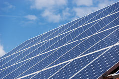 Energy photovoltaic solar panels on roof of residential house Stock Photos