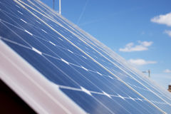 Energy photovoltaic solar panels on roof of residential house Royalty Free Stock Images