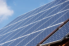 Energy photovoltaic solar panels on roof of residential house. Alternative energy photovoltaic solar panels on roof of residential house Stock Images