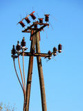 Old electricity pylon. On transmission tower with blue sky background royalty free stock photography