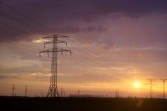 Energy pole. On dramatic sunset sky. Electric distribution stock photos