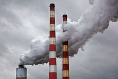 Energy Pollution. Smoke and steam emissions from coal burning power plant Stock Photos