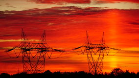 Energy posts in sunrise Stock Image