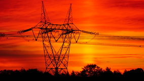 Energy posts in sunrise. Hydro Quebec energy lines raise in the morning sunrise Stock Image