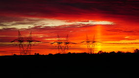 Energy posts in sunrise. Hydro Quebec energy lines raise in the morning sunrise Stock Photo