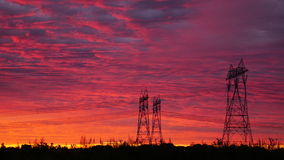 Energy posts in sunrise. Hydro Quebec energy lines raise in the morning sunrise Royalty Free Stock Image