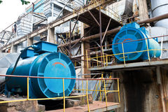 Steam power engines. Big steam power engines inside thermal power plant courtyard stock image