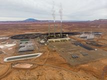 Energy power plant in the desert with smoking tubes. Stock Photo