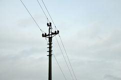 Energy Power pole in cloudy weather Royalty Free Stock Image