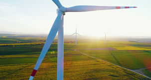 Energy Production background. Windmills on agricultural fields background. Windmill and Wind power technology background. Aerial view on Wind Power, Turbine stock footage