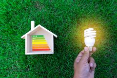 Energy rating chart Eco man energy efficiency scale image. W stock image
