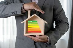 Energy rating chart Eco man energy efficiency scale image. W stock images