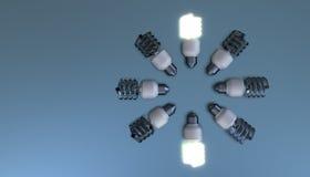 Energy save bulbs. On blue background Stock Photography