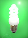 Energy save lamp on green background. Royalty Free Stock Photo