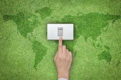 Free Energy Saving And Ecological Friendly Concept With Hand Turning Off Switch On Green Grass Lawn With World Map Stock Photography - 186159802