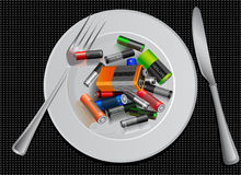 Energy saving. battery on a plate. Sports nutrition. funny creative advertising. Royalty Free Stock Photo