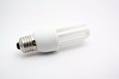 Energy saving bulb. Fluerescent energey saving lamp bulb on isolated background Stock Image