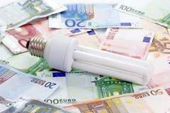 Energy Saving Bulb. On Euro bills stock image