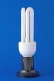 Energy saving bulb on the background. Energy saving bulb on the blue background Stock Photos