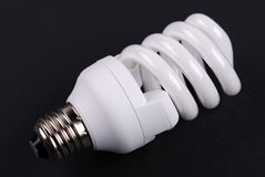 Energy saving bulb on black. Background royalty free stock photos