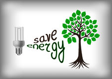 Energy saving bulb with green tree Royalty Free Stock Photo