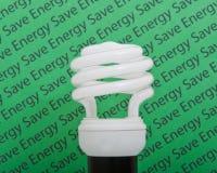Energy saving bulb / lamp. Low wattage energy saving bulb / lamp on save energy background Royalty Free Stock Photo