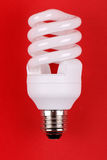 Energy saving bulb on red Stock Photos