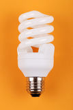 Energy saving bulb on yellow Stock Photo