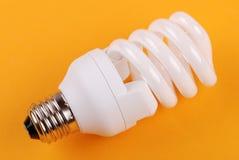 Energy saving bulb on yellow Royalty Free Stock Photo