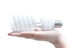 Energy saving concept, Woman hand holding light bulb  isolated on white background Royalty Free Stock Photography